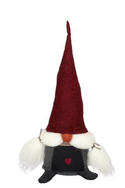 Tomte Vera mit roter Mütze